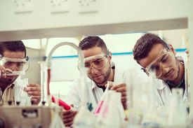 picture of conduction  - Group of scientists conducting research in a lab environment - JPG