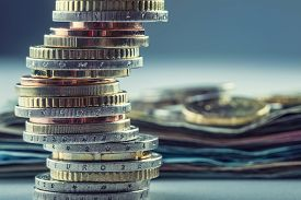 foto of money  - Euro coins. Euro money. Euro currency.Coins stacked on each other in different positions. Money concept - JPG