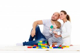 picture of sweet dreams  - Happy family with sweet baby build house on a white background - JPG