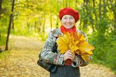 Woman With Maple Leaves In Autumn Park