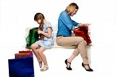 picture of wonderful  - Happy mother and daughter with shopping bags sitting at studio - JPG