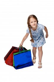 pic of heavy bag  - Happy girl with shopping bags standing at studio - JPG