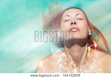 poster of Enjoy the summer. Woman relaxing in the pool water. A beautiful woman floating in water in a swimming pool. Relaxation and peace. Eyes closed and wellness enjoyment in the summer.