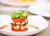 Delicious salad or appetizer with tomatoes, lettuce, crisp bacon, chicken breast, hard-cooked eggs,