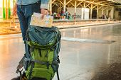 Backpacker Waiting For Long Journey Travel At Train Station With Backpack. Travel Concept With Vinta poster