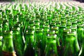 Bunch of green glass bottles. Soft focus.