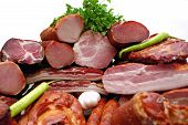 stock photo of smoked ham  - Smoked meat with paprika bulb and parsley decoration - JPG