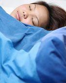 image of have sweet dreams  - Young asian woman fast asleep in her bad having sweet dreams - JPG