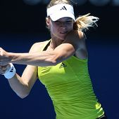 MELBOURNE, AUSTRALIA - JANUARY 26: Maria Kirilenko in her quarter final loss to Jie Zheng during the