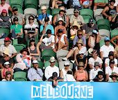 MELBOURNE, AUSTRALIA - JANUARY 27: Crowd watch a tennis game at the 2010 Australian Open at Rod Lave