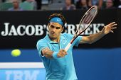 MELBOURNE - JANUARY 27: Roger Federer hits a backhand in his win over Nikolay Davydenko during a qua