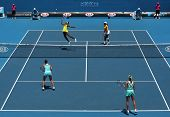 MELBOURNE, AUSTRALIA - JANUARY 24: Doubles match Serena & Venus (Top L) Williams vs Andrea Hlavackov