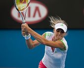 MELBOURNE - JANUARY 25:  Maria Kirilenko of Russia in a mixed doubles match at the 2011 Australian O