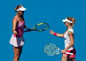 MELBOURNE - JANUARY 28: Maria Kirilenko of Russia (R) with partner Victoria Azarenka of Belarus in t