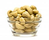 pistachios in a dish on white background
