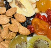 stock photo of dry fruit  - dried fruits and nuts in plate - JPG
