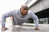 Fitness Black Man Exercising Push Ups In Urban Background poster