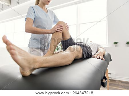 poster of Patient At The Physiotherapy Doing Physical Exercises With His Therapist