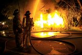 Firefighters suppress blazing fire