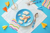 Fun Food Idea For Kids. Childrens Breakfast: Plane Made Of Banana And Clouds Made Of Curd On A Blue poster