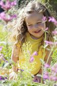 Happy girl in sun with flowers 55