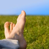 relaxed foot on grass