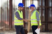 Engineers Shaking Hands On Construction Site poster