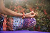 woman practice yoga meditation hands in mudra gesture closeup outdoor autumn day poster