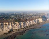 Townscape Aerial View Seen From The Sea With Cliffs poster