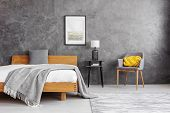 Grey Blanket And Pillow On The Wooden Bed With White Bedding In Stylish Bedroom Interior With Concre poster