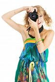 Cheerful young woman shooting with a digital photo camera
