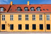 Colorful Roof And Facade Of Old Building In Traditional Style In Copenhagen, Denmark. Historical Tow poster