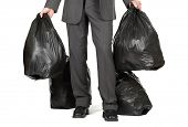 Businessman taking out the trash concept for leadership, starting over or new beginnings