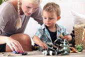 stock photo of babysitting  - Mother playing with her little boy - JPG