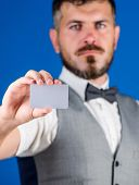 Plastic Bank Card Copy Space. Easy Money Credit. Man Bearded Hipster Hold Blank Card Blue Background poster