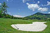 Golf field and beauty surroundings in mountains