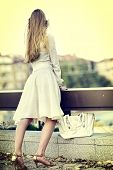 Fashion woman in autumn spring dress on city street. Sosial isoltion female style of feminine fashio poster