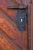 stock photo of door-handle  - Old handle in wooden doors  - JPG