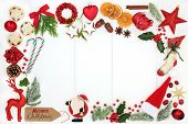 Christmas background border composition with traditional symbols of bauble tree decorations, candy c poster