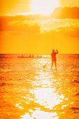 Hawaii ocean lifestyle - watersport activity on ocean - stand up paddleboard, people training on out poster
