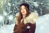 Winter Woman In Snow Looking At Camera Outside On Snowing Cold Winter Day. Portrait Caucasian Female poster