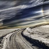 Village Road In Winter. Very Cold Weather, Cloudscape And Sun Halo In Sky. poster