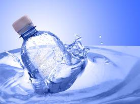 stock photo of bottle water  - plastic bottle in water splash - JPG