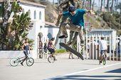 OCEANSIDE, CALIFORNIA - AUGUST 19: Skateboarder Alex Garcia practices aerial tricks on his board on