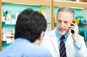 picture of erectile dysfunction  -  Pharmacist dealing with a customer - JPG