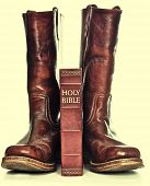 Rugged cowboy boots and bible