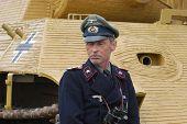 KIEV, UKRAINE -MAY 13: Member of Red Star history club wears historical German uniform during historical reenactment of WWII, May 13, 2012 in Kiev, Ukraine