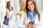 picture of hall  - Female student listen mp3 player in high school hall - JPG