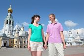 Young couple near Holy Resurrection cathedral, Alexander Nevsky church on Kremlin square in Vologda, Russia