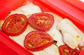 stock photo of hake  - some slices of hake cooked en papillote with slices of tomato and other vegetables - JPG